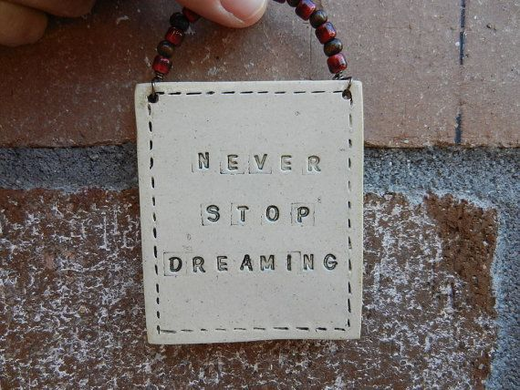 Ceramic sign  Never stop dreaming inspiration by potteryhearts