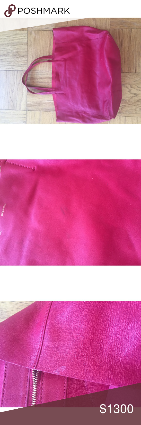 """Celine Thin Red Leather Tote Bag This bag is in 5/10 condition. There are signs of wear. There are dark marks on the outside of the bag. There is a water stain on the inside. The inside is suede material. There are white marks on the inside. Willing to negotiate a decent price. This bag measures about 22"""" H from the the strap. And measures about 19"""" W. Celine Bags Totes"""
