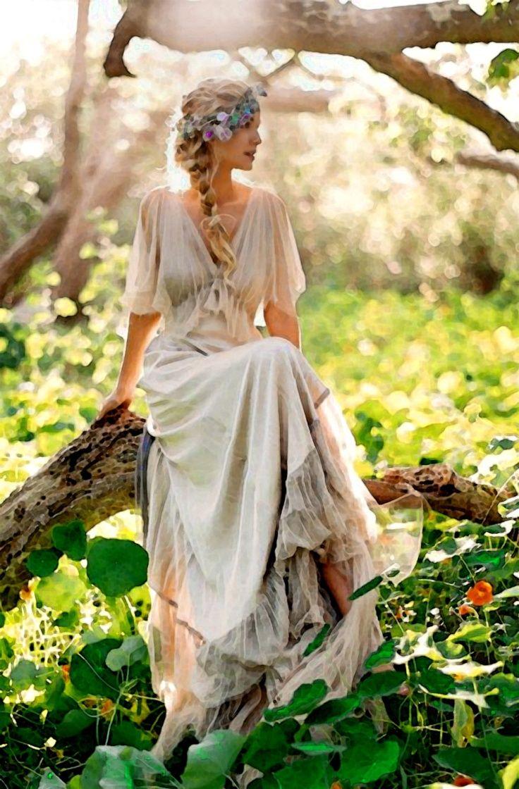 Elegant bohemian gown with floral crown fairytale designs website