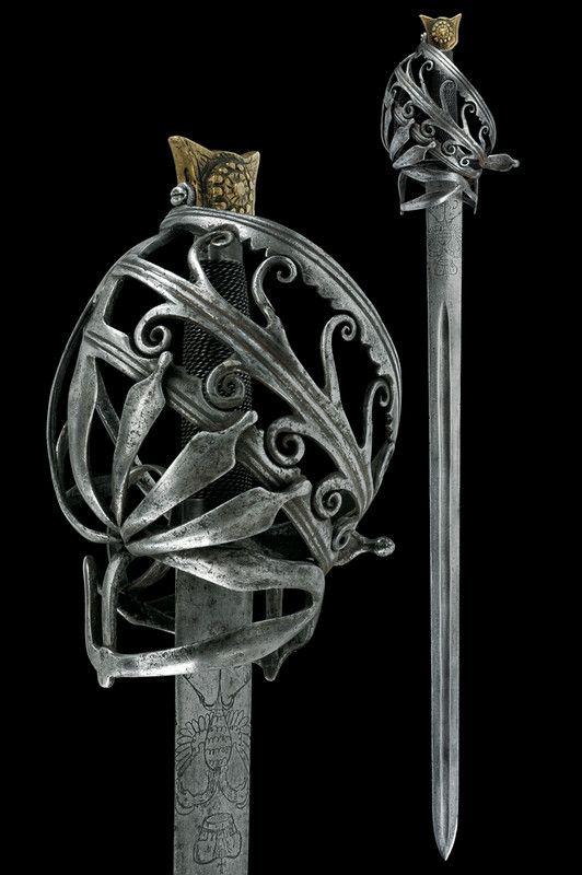 Schiavona ca. 1732-40. La hoja muestra un águila bicéfala y la inscripción C VI, probablemente alusiva a Carlos VI de Habsburgo (1684-1740), emperador del Sacro Imperio Romano Germánico, y, a la muerte de Carlos II de Austria en 1700, pretendiente al trono de España.