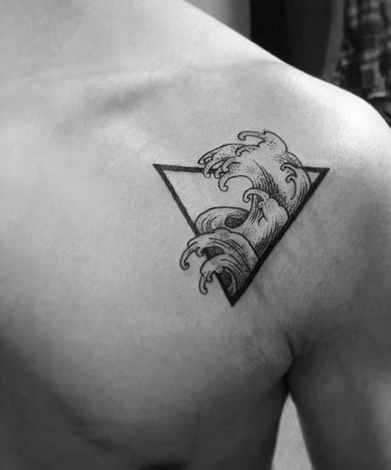 Ocean-wave-triangle-guys-simple-upper-chest-tattoo-designs