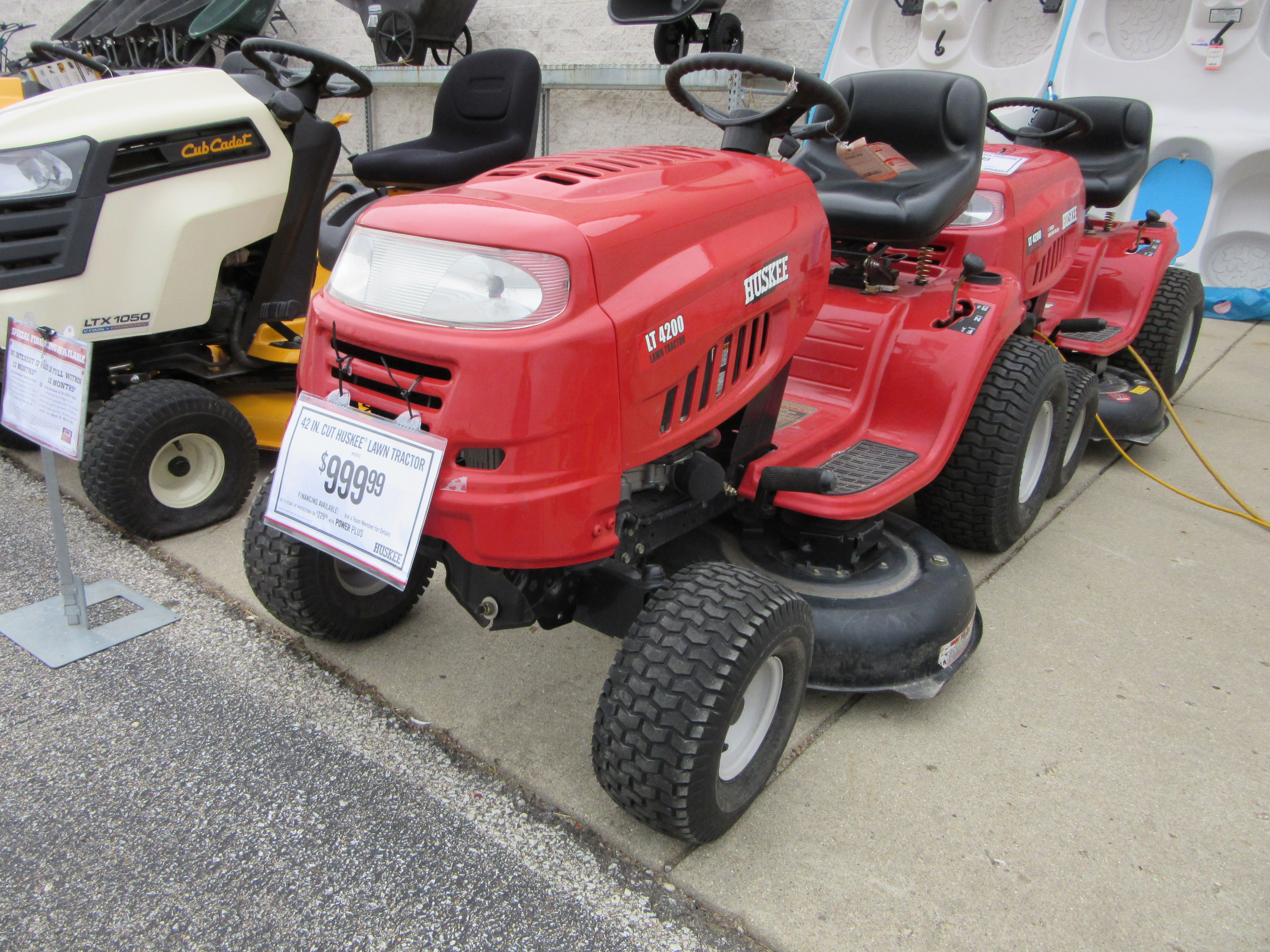 Red Huskee LT4200 rider with 7-speed transmission