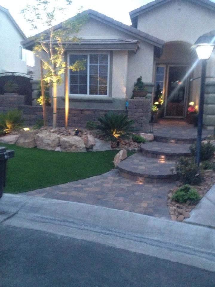 My new yard with paver walkway and artificial turf