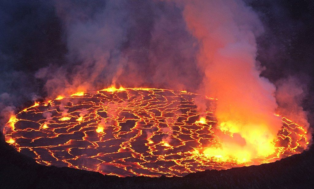 Amazing photographs captures world's largest lava lake and 'firework eruptions' on the most active volcanoes on Earth