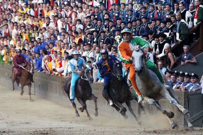 Palio di Siena Travel Guide Introduction Other than its historical buildings, part of Siena's cultural identity would be the Palio, an annual four-day horse racing event which causes life in Siena to pause every July 2 and August 16 as residents celebrate and enjoy the race itself as well as the various events and amusements that accompany it. The first race, the Palio di Provenzano is held on July 2 in honor of the Madonna of Povenzano and her church in Siena. Meanwhile, the second race…