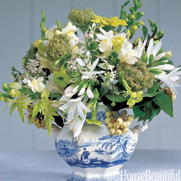 """""""Flower arrangements should look easy and natural. I like to assemble a small bouquet in my hand, then tie the stems to hold it together before putting it in a container."""" Bunny Williams"""