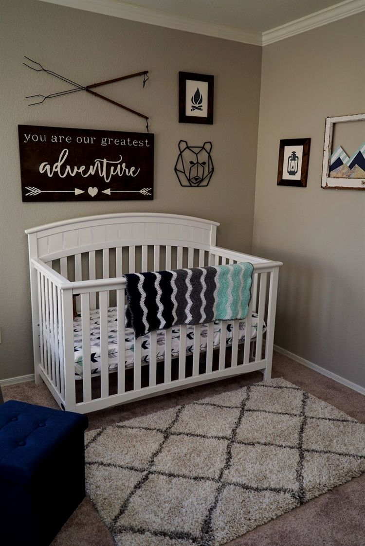 Adventure themed nursery in mint navy and white baby boy nursery