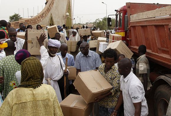 Volunteers load a truck with medical supplies for a humanitarian shipment funded by Malian donations and destined for rebel-controlled Timbuktu and Gao, in the capital, Bamako, Mali, Friday, April 13, 2012.