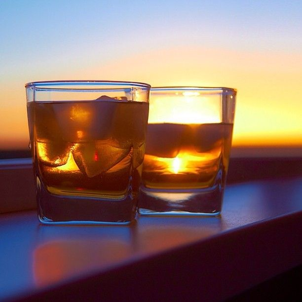 The Sun is in a glass of whiskey..I love it..