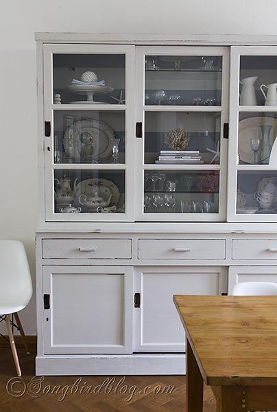 milk paint white hutch makeover via Songbirdblog