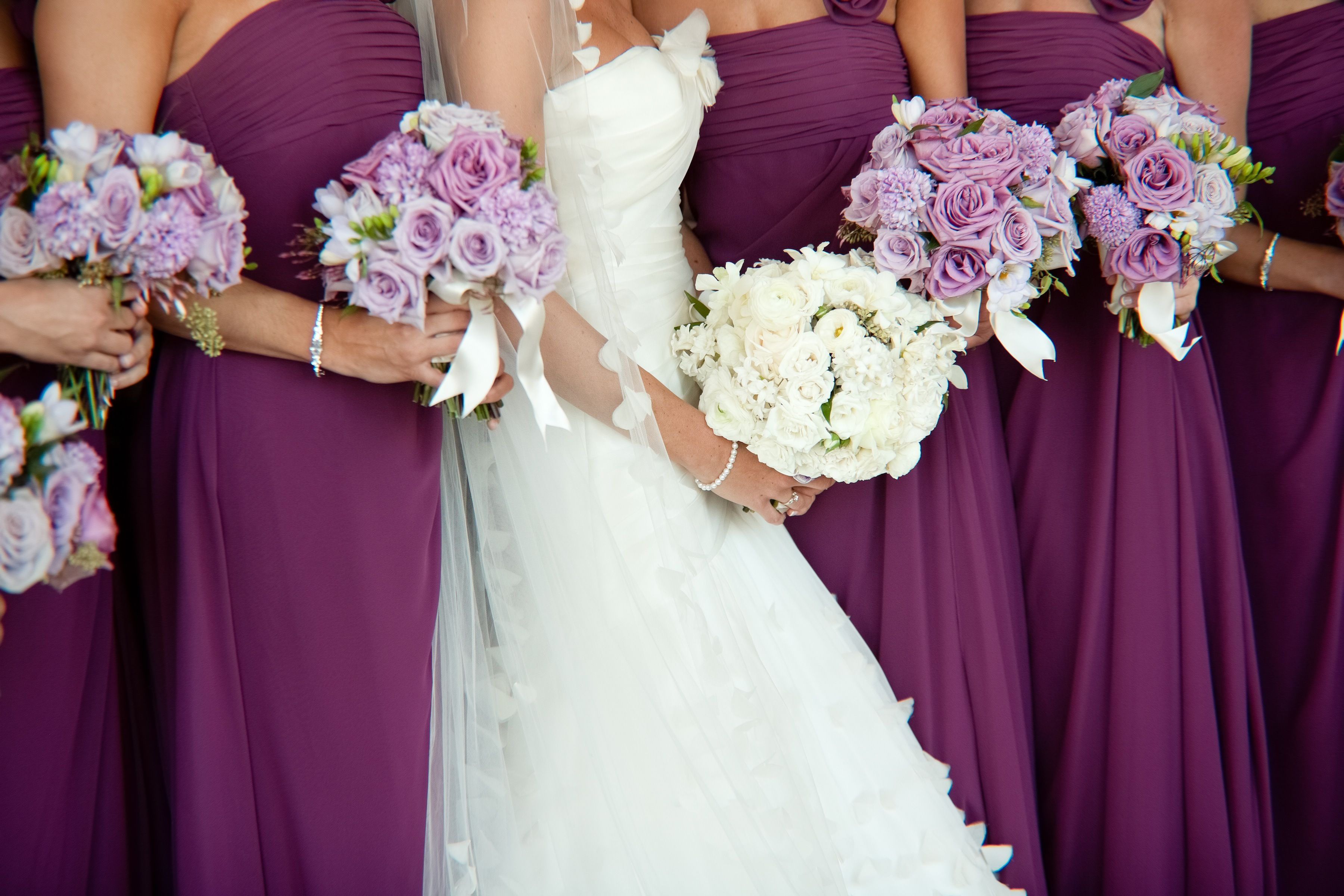 Purple Bridesmaids dresses with lavender and white rose bouquets ...