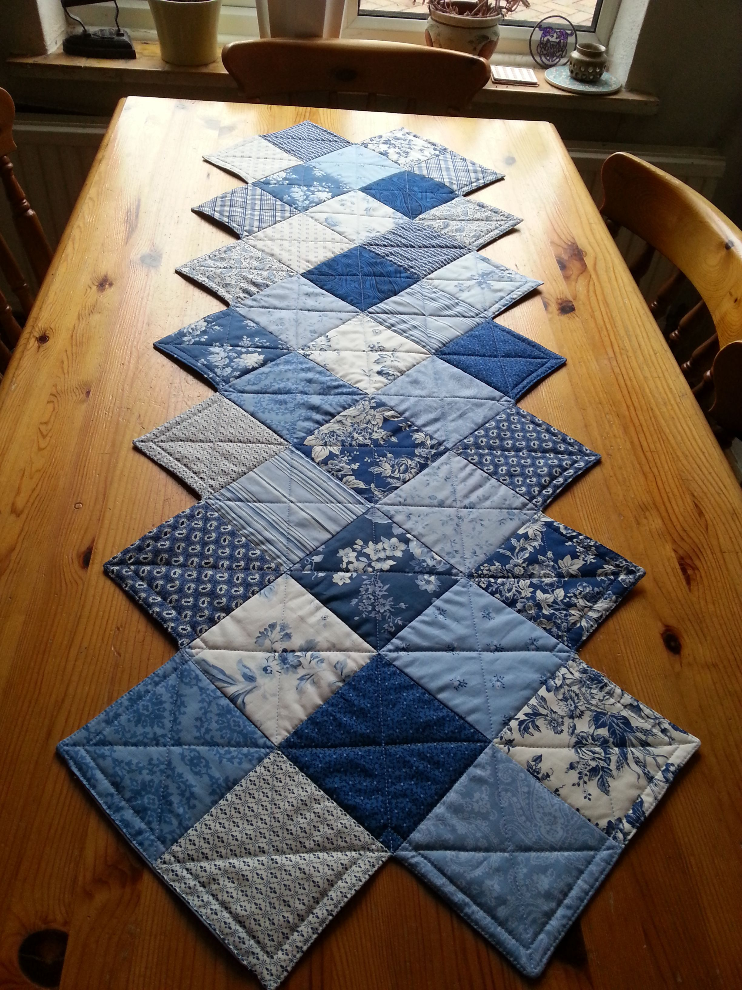 A Zig Zag Table Runner Made With A Charm Pack Pattern From The Missouri Star Quilt C Quilted Table Runners Patterns Table Runner Pattern Quilted Table Runners