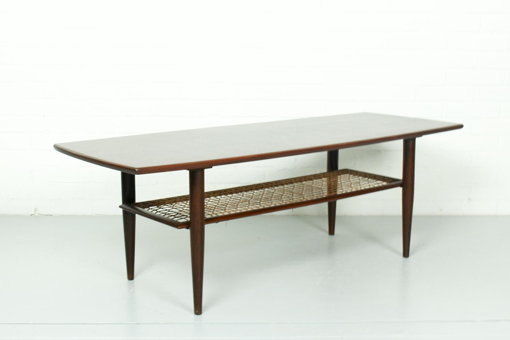 Vintage teak coffee table with rattan magazine rack 1960s