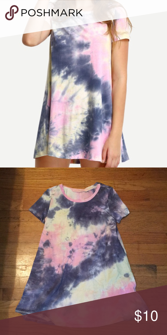 Tie Dyed T-shirt Dress Never been worn brand new. Now it is a size small and it fits everywhere besides the length for me. I'm 5'6 and it's just too short on me. So this can be worn as a regular shirt or if you're shorter than me it could be a dress! It's 100% cotton and very comfy! Dresses Mini
