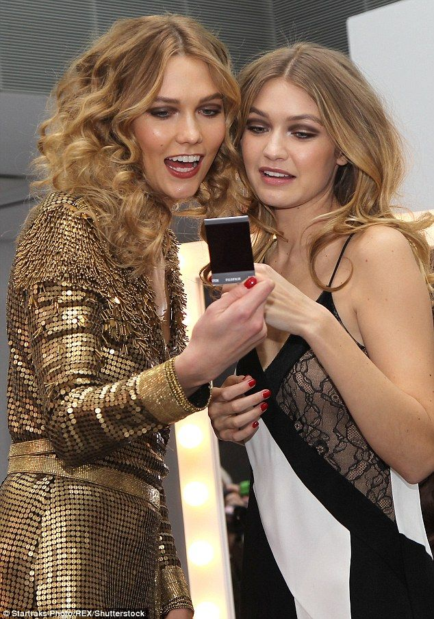 What do you think? Karlie looks pretty pleased with one of their photos, but Gigi appeared...