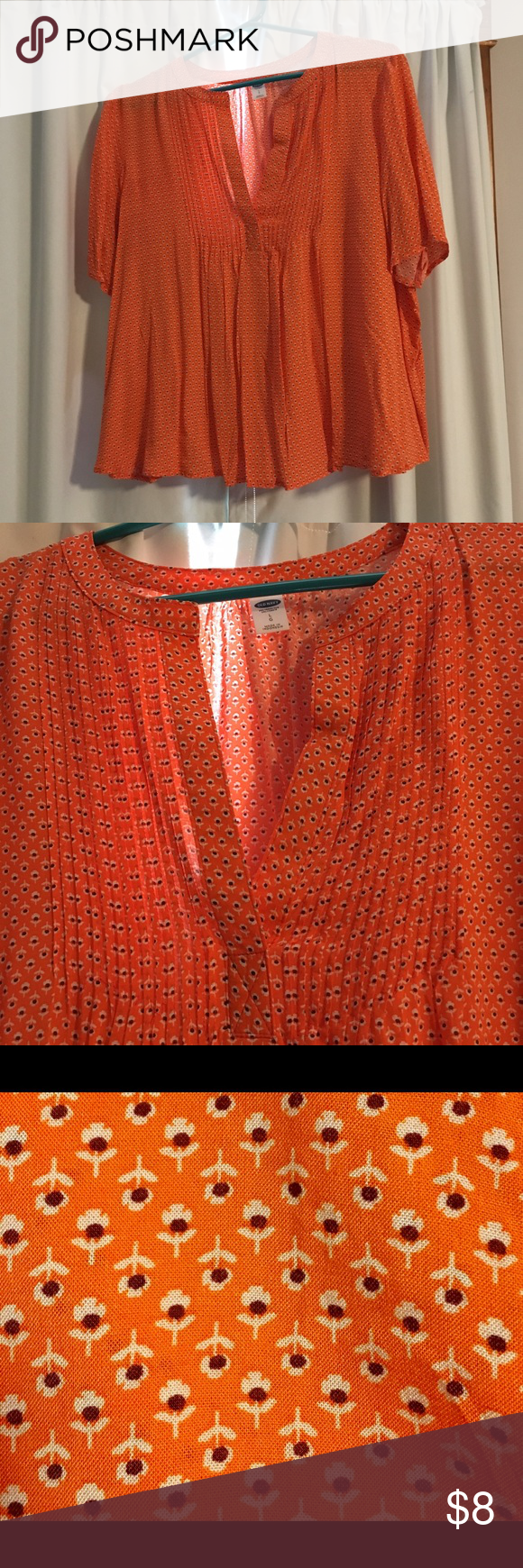 Orange Blouse Lightweight blouse; floral pattern; V-Neck with pleated front detail. Length hits barely below waist so it is more of a cropped than average length. Worn once. No trades. Old Navy Tops Blouses
