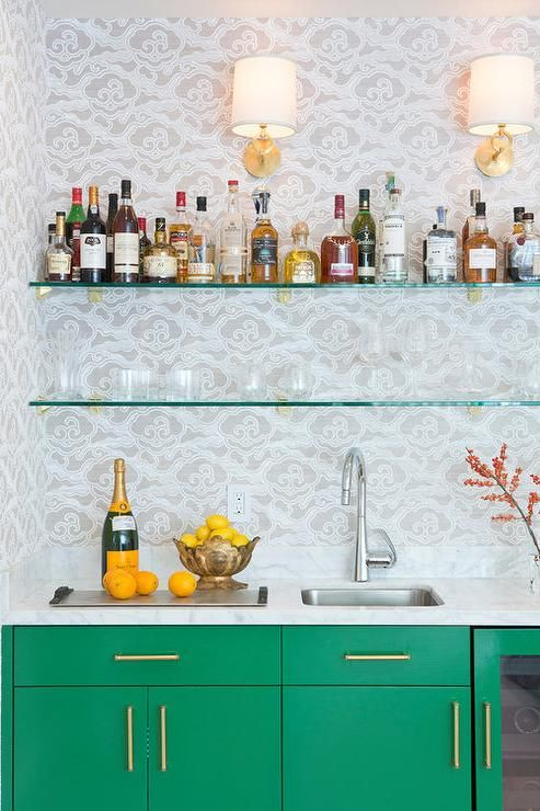 Two Seamless Stacked Glass Shelves Mount The Walls Over An Emerald Green  Wet Bar.