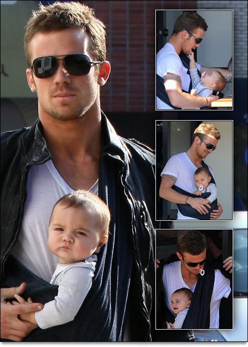 hot, hot daddy :) LOVE it! Hope I find a guy secure enough to carry the baby in a sling...not to mention the HOT factor ;)
