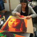 Skittle Mosaic Portraits - use Photoshop filters to student picture before translating into a Skittle candy portrait.  Also see Apex H.S. site on how to do this:  http://apexhsart.blogspot.com/2010/08/post-it-note-project-explained.html