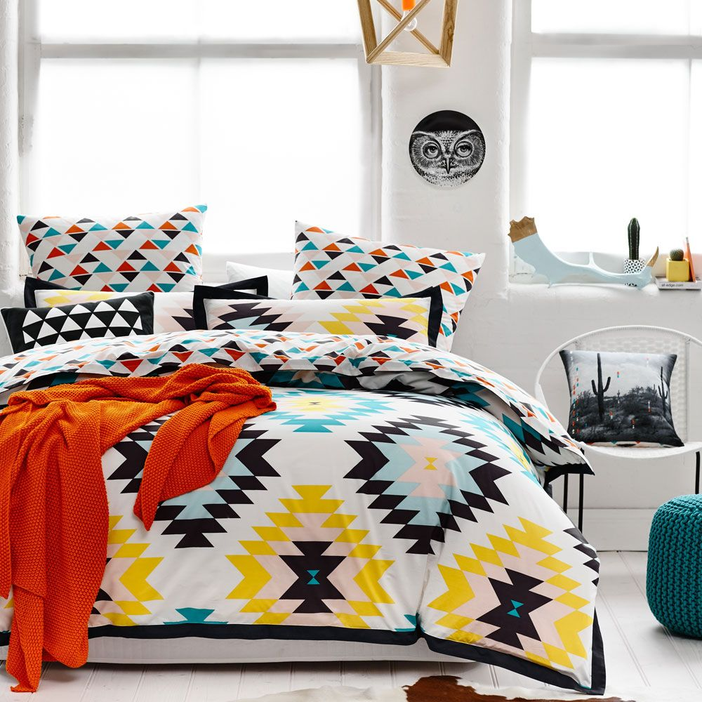 A fun and modern interpretation of traditional Aztec patterns, the Arizona quilt cover is a stand out design from the Home Republic range. Printed on luxury cotton fabric and finished with a 5cm tonal flange, this design will certainly make a statement in your bedroom. Complete this bold, colourful look with coordinating geometric European pillowcases.Â