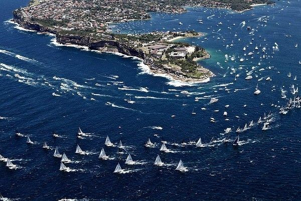 The fleet leaves Sydney Harbour set against the back drop of South Head.