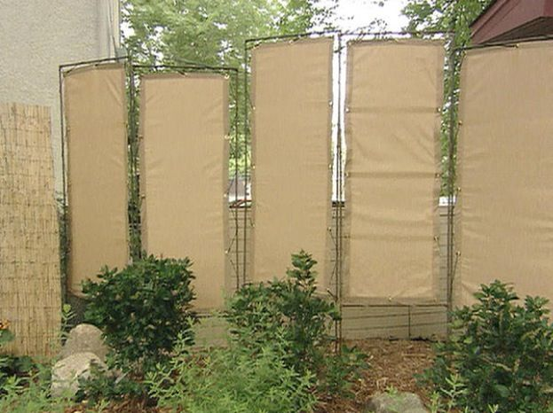 Cool canvas privacy diy fence. I would paint them though ;-) | Y ...