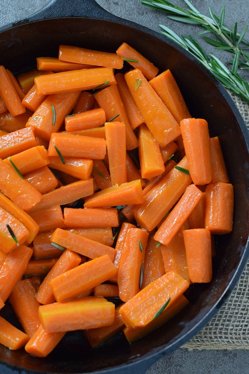 Honey Glazed Carrots with Rosemary - Adventures of Mel Honey Glazed Carrots, made with 4 simple ingredients. Delicious side dish recipe you can add to your holiday or weeknight menu.