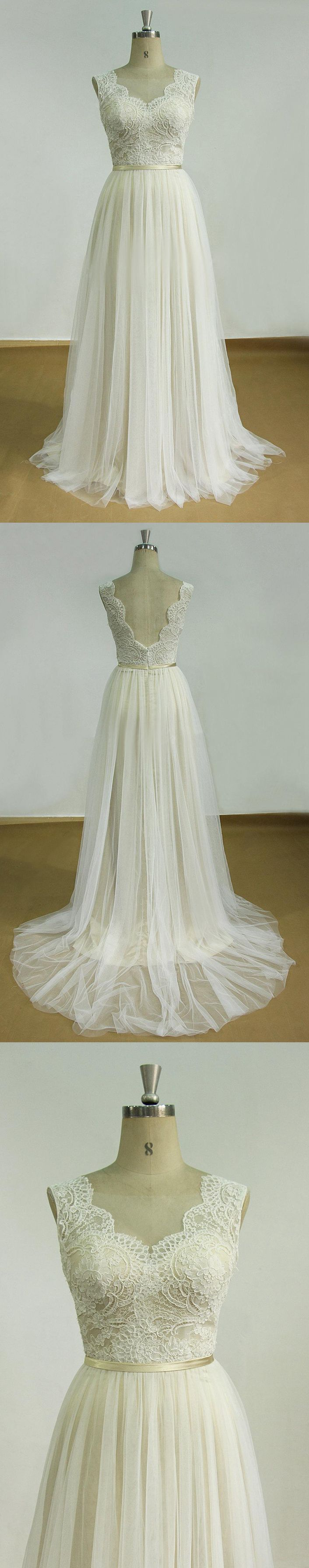 Backless tulle lace satin weddig dress wedding dress on mannequin