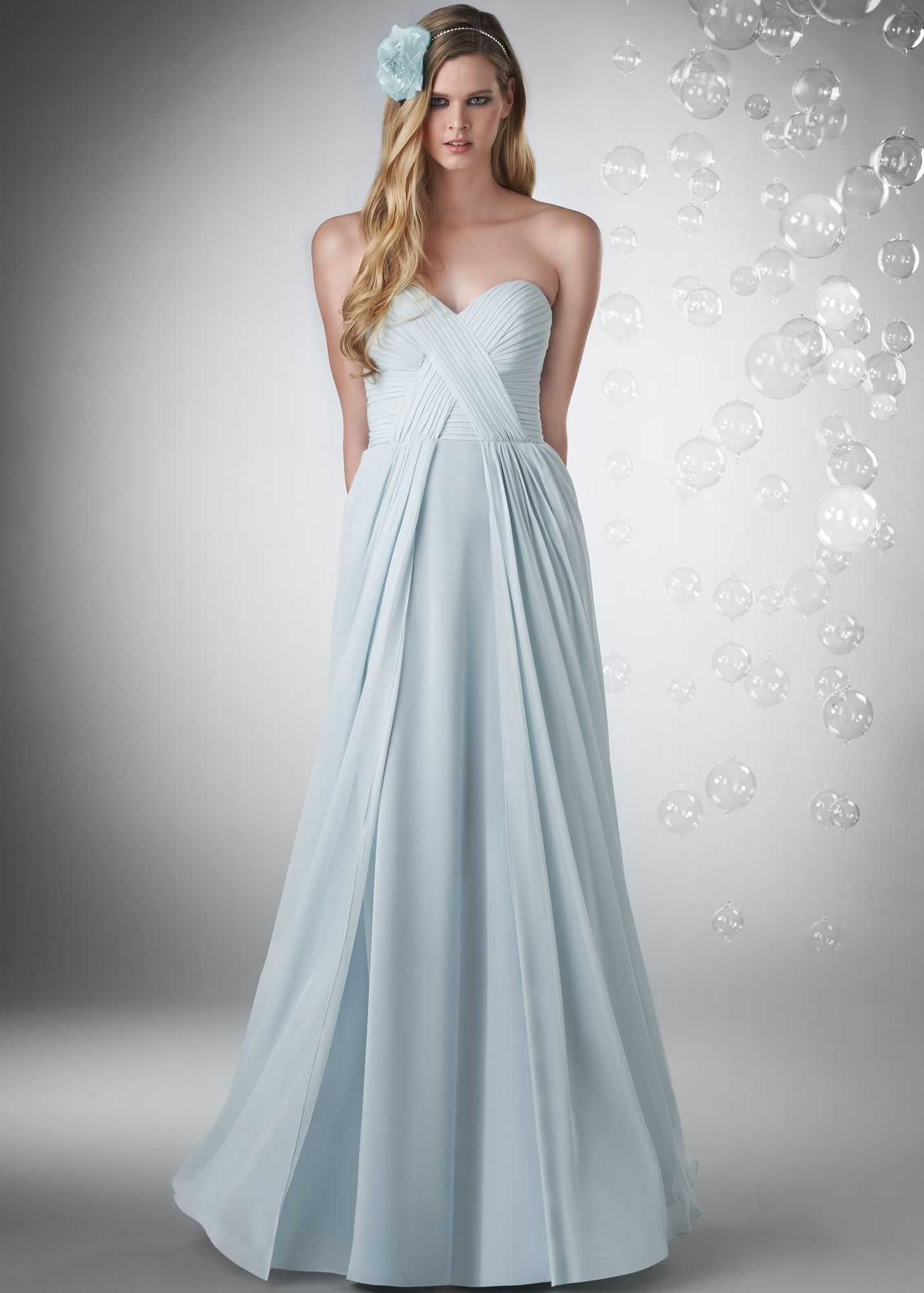 We have this in a dark gray called shadow bari jay strapless long