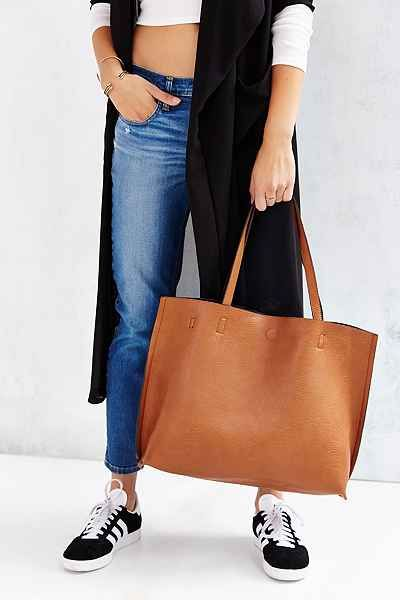 7e1c3c7852c6 Reversible Vegan Leather Oversized Tote Bag in Honey - Urban Outfitters