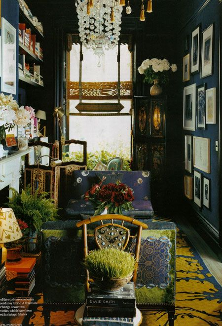Love the chandelier and many frames on the wall. inspiration for my entryway