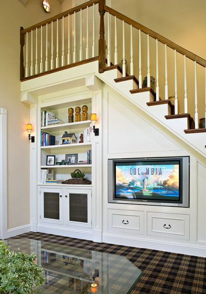 A Staircase With Bookshelves And A Tv Integrated And Some Storage Drawers Saves A Lot Of Storage S Living Room Under Stairs Staircase Storage Room Under Stairs
