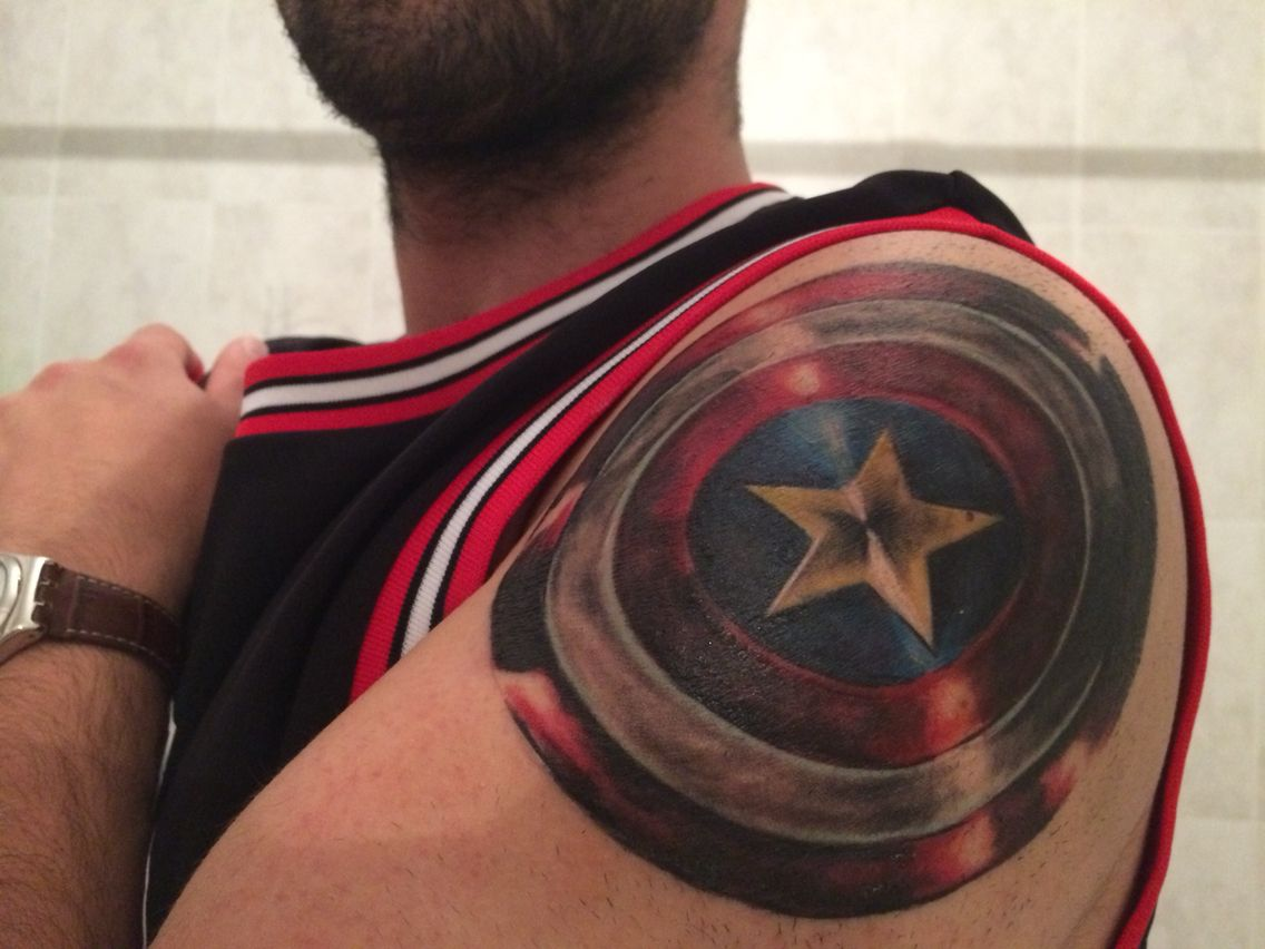 Texas letters with clown faces tattoos by stevie garza - Captain America Shield Shoulder Tattoo By Orlando Gon Alves