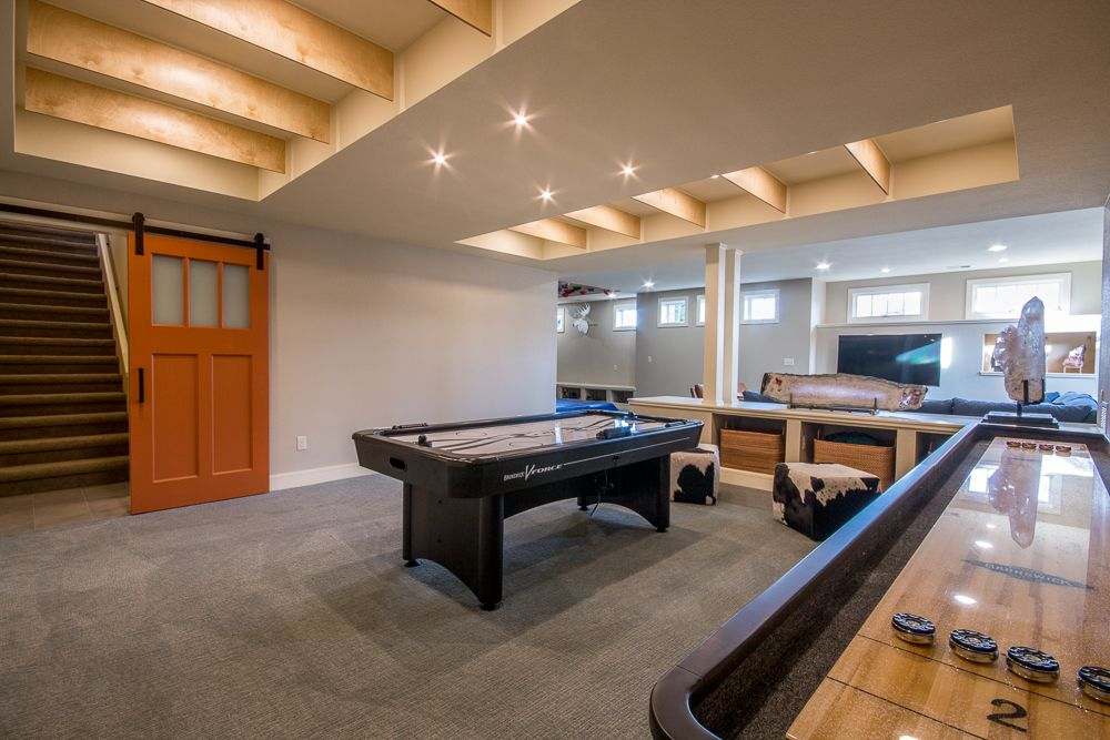 Basements Remodeling basement remodel with barn door, game room, family room and