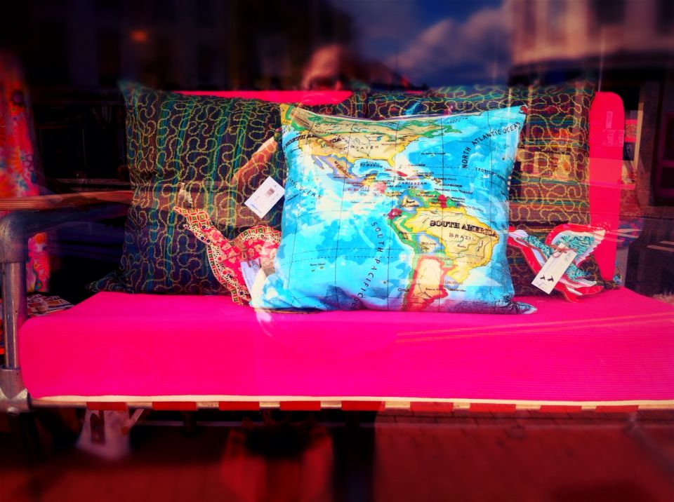 Scaffolding settee in pink cord. Recycled fire hose webbing. Beautiful map cushions £20