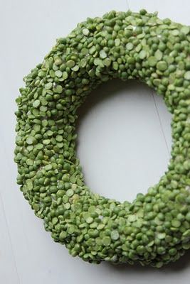 Split peas hot glued (one small section at a time) onto a small straw wreath. Add a funky bow and this could be super cute!