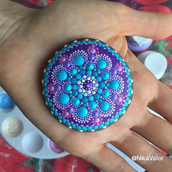 Thank you for visiting this page. Welcome to NikaValorArt. I created this whimsical Mandala Stone entirely from colorful dots - dot by dot, in pretty colors! Materials I used: Natural ocean stone, high-quality acrylics. Varnished for protection. Dimensions: 2.5 inches in diameter. *** If you love this item, but the price is a bit steep for you, message me with your bid and I will consider it. I will be traveling in summer and hope to find new homes for these creations before then…