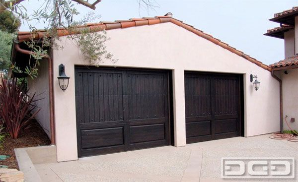 Rich Dark Almost Black Stain On Custom Cedar Garage Doors Garage Door Decor Custom Wood Garage Doors Garage Door Styles