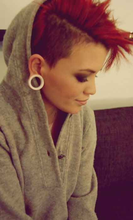 Shaved sides. Undercut. Sidecut. Red alternative hair. Some women can just pull this off beautifully!!