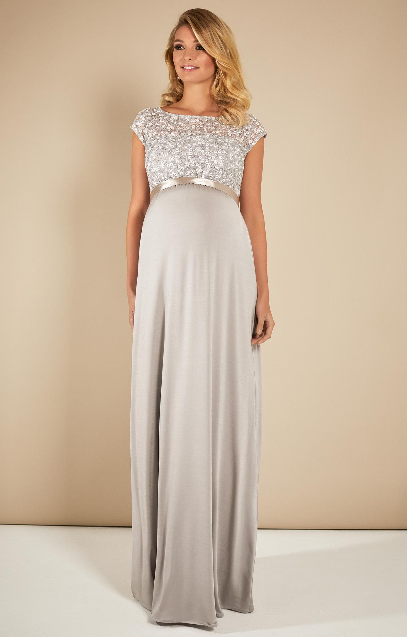 2291e01b082c8 A silver sequin encrusted bodice is beautifully designed with a soft jersey  floor length maternity gown for after dark glamour. The lace, embroidery  and ...