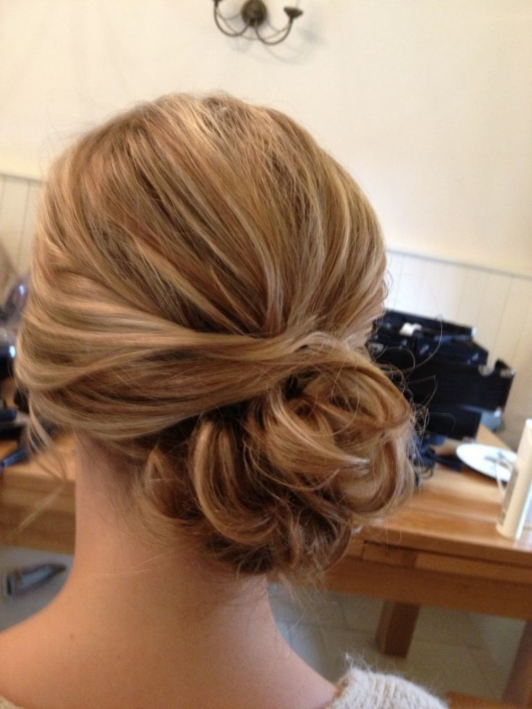 bridesmaid hair to the side messy low bun with bangs make it