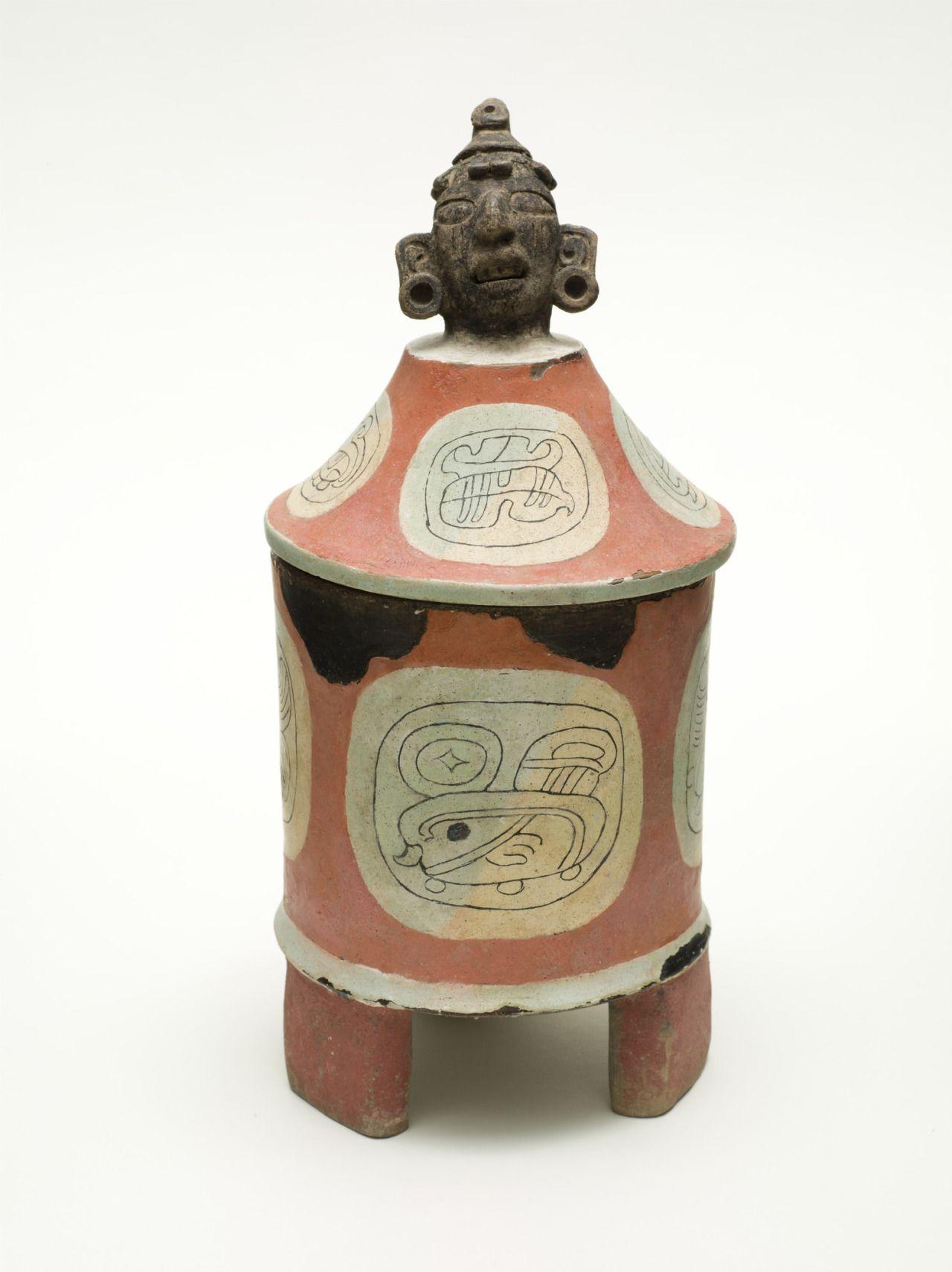 "tlatollotl: ""  Lidded Tripod Cylinder Vessel with Head of Cacao Deity Guatemala, Northern Peten, Naranjo or vicinity, Maya, Early 5th Century LACMA """
