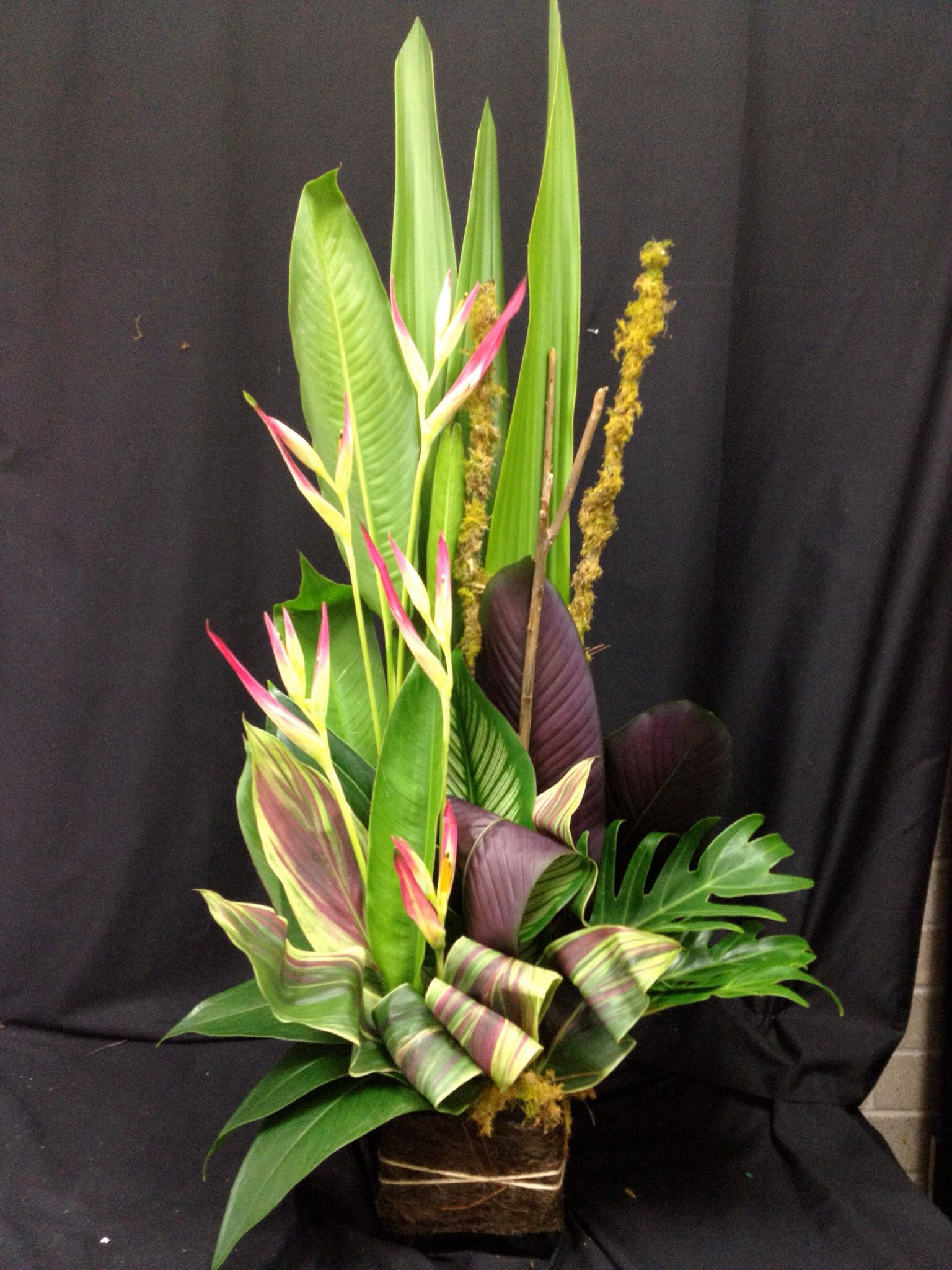 Heliconia And Cordyline Flower Arrangement Tropical Flower Arrangements Modern Flower Arrangements Flower Arrangements