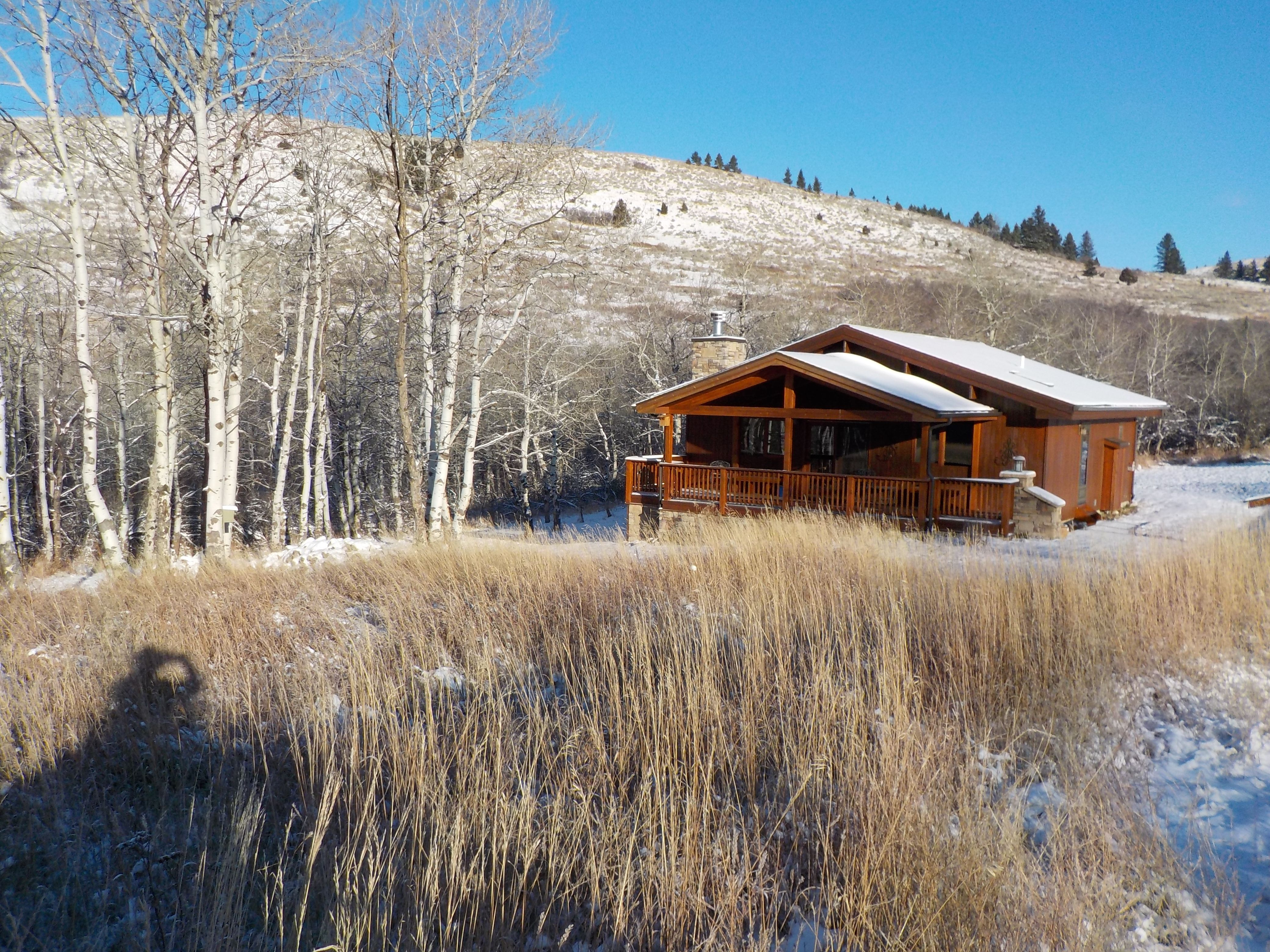 The bungalow in winter, elk sign all around.  A couple years ago a wolf was spotted over the hill to the north.