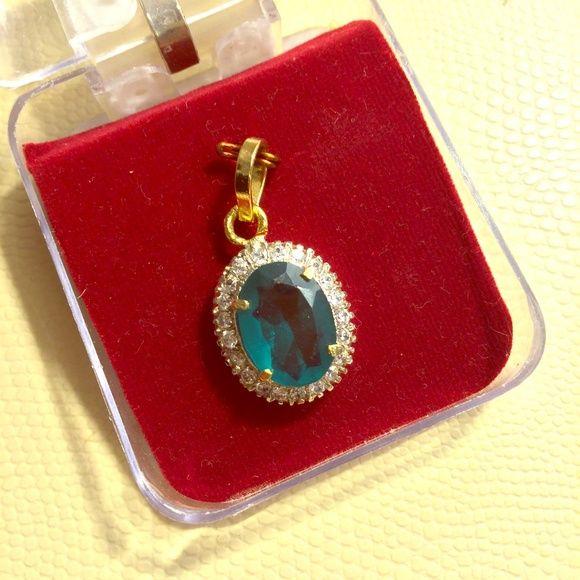 Fake But Fun Pendant Fake but fun pendant, emerald colored center, fake diamonds around, fake gold setting, in a little plastic case Jewelry