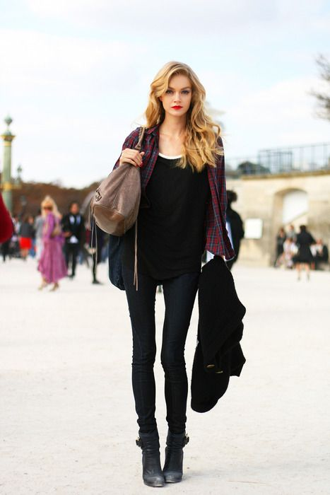 Plaid shirt over a black top paired with black pants. Blonde, wavy ...