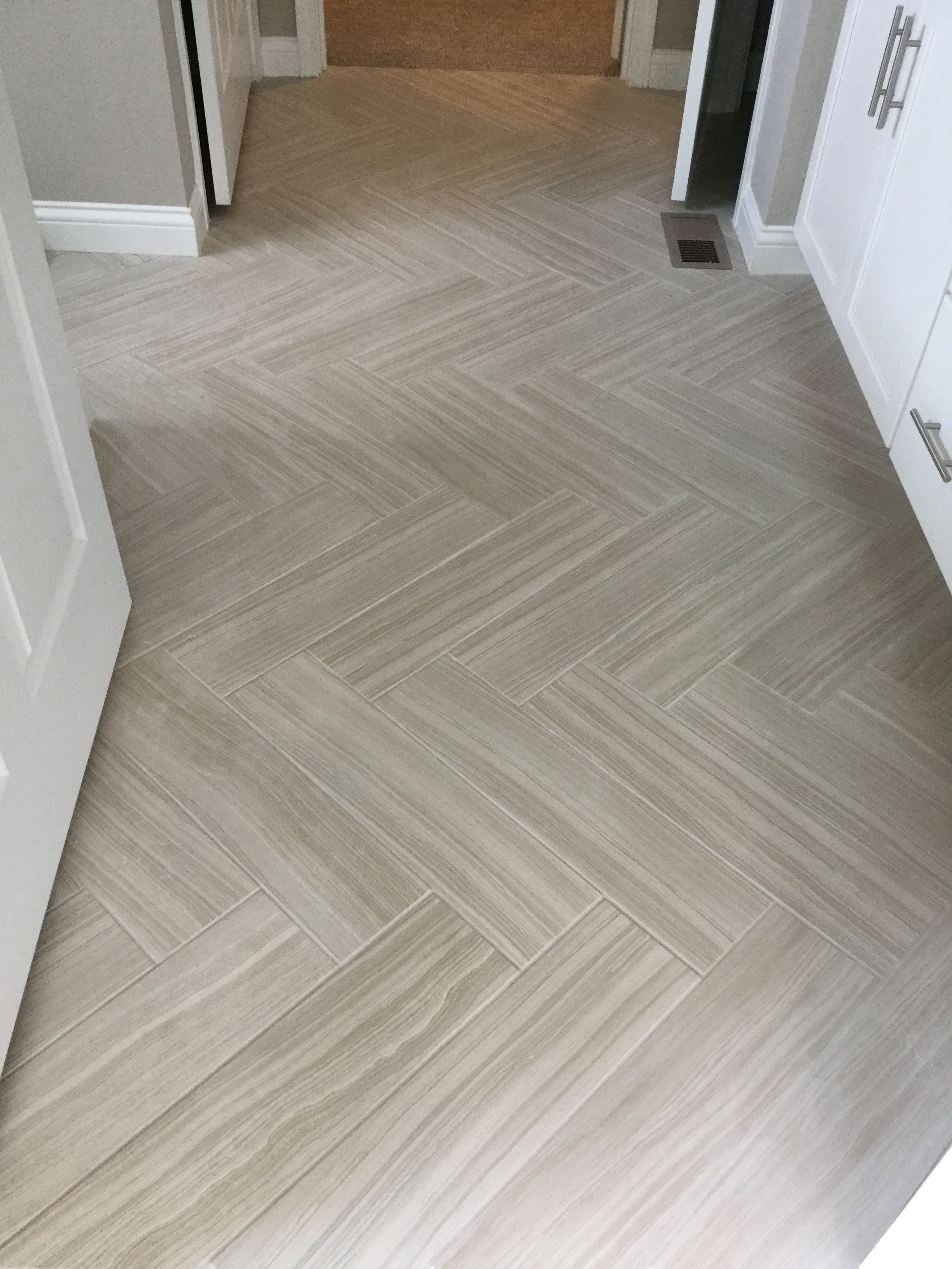 Santino Bianco 6x24 Tiles In Herringbone Pattern On Floor Of Bathroom Herringbone Tile Floors Tile Floor Patterned Floor Tiles