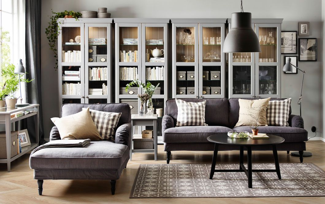 living room chaise lounge ideas how to arrange small with tv a grey three seat sofa and black round coffee table combined four glass door cabinets