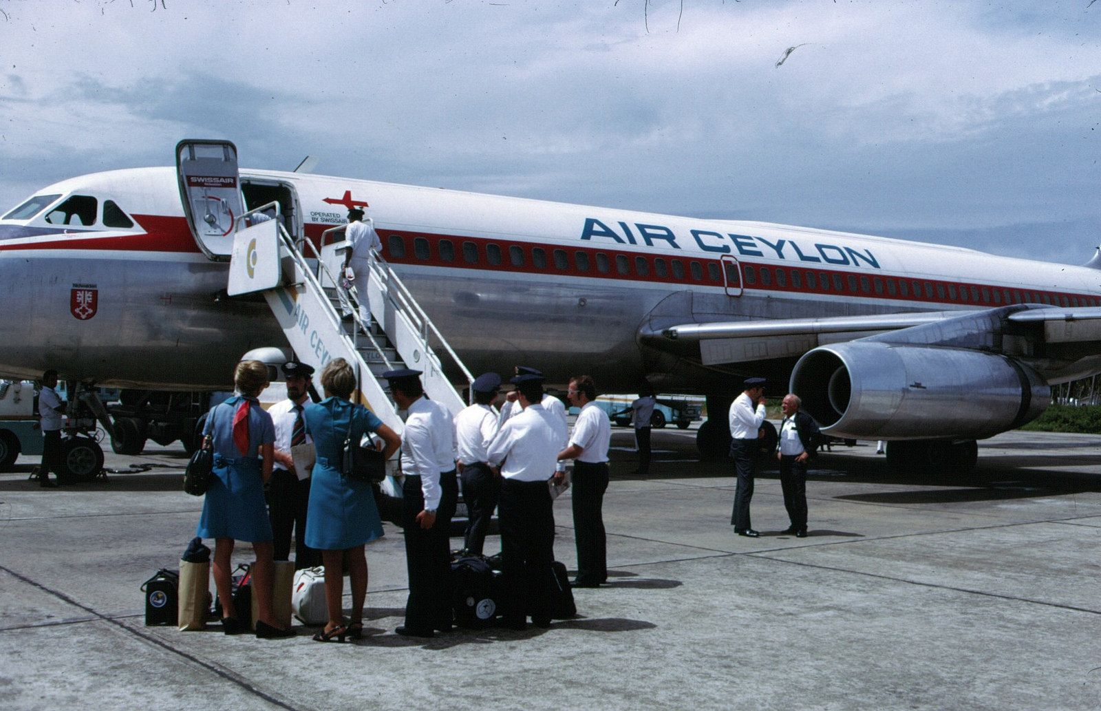 Convair CV-990   Flickr - Photo Sharing!  Air Ceylon titles on a Swissair 990. This looks like a wet lease, with crew and all (foreground).