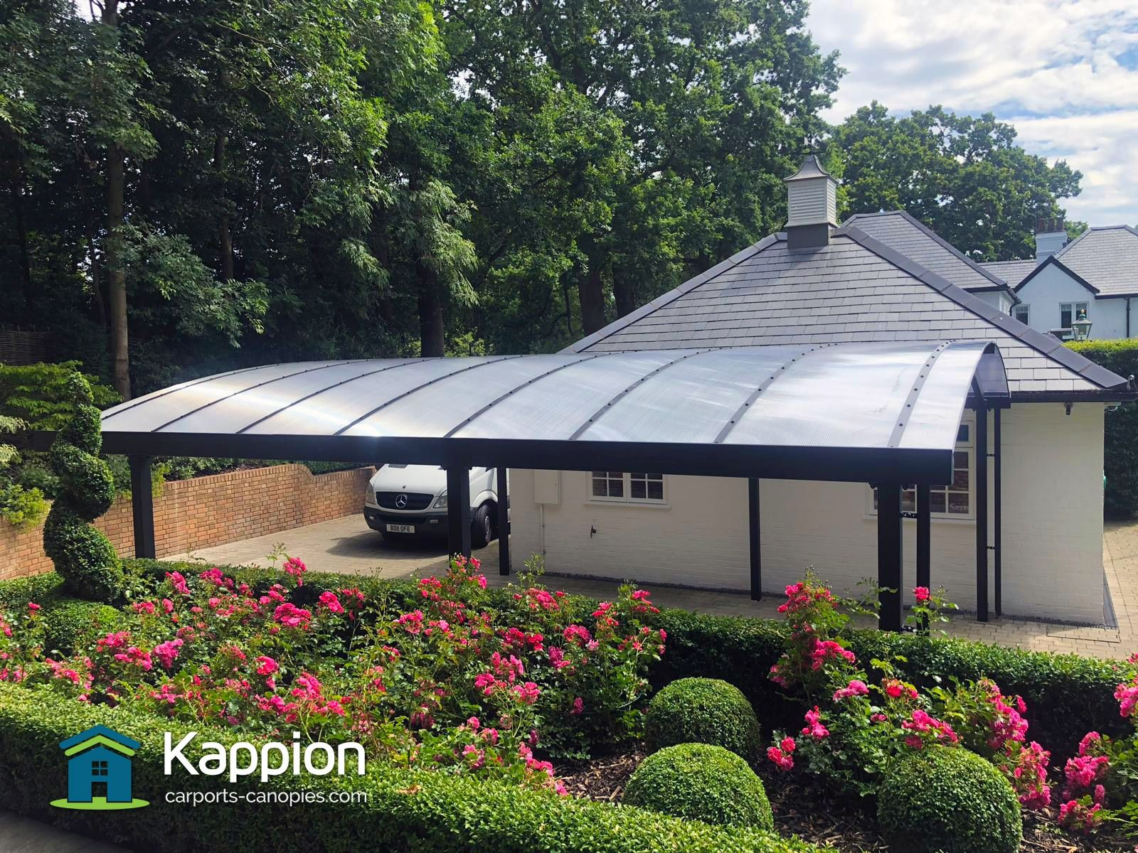 A contemporary curved carport installed next to a